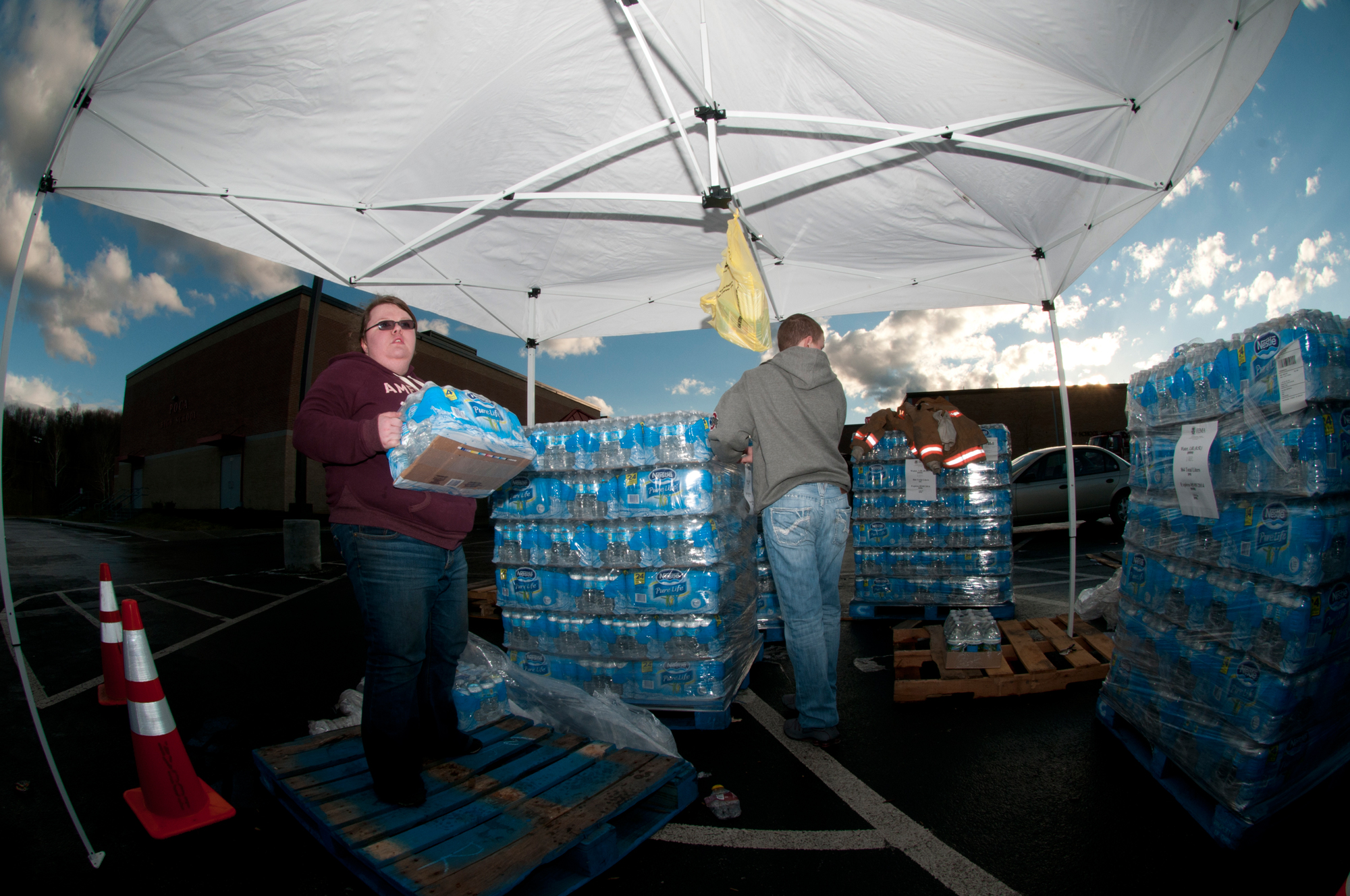 Living on earth bad data for bad water bethany whisman and blake kenney both of poca w volunteer by handing out cases of bottled water to those affected by the elk river water publicscrutiny Image collections