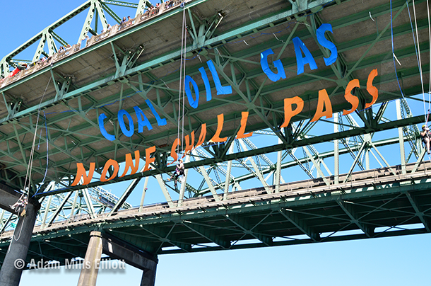In July 2013, the climate action group Rising Tide hung a banner from the Interstate Bridge in Portland that read 'Coal, oil, gas, none shall pass.' (Photo: Adam Elliot/Portland Rising Tide; Flickr CC BY-NC-SA 2.0)
